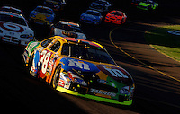 Nov 13, 2005; Phoenix, Ariz, USA;  Nascar Nextel Cup driver Elliott Sadler driver of the #38 M&M's Ford leads a pack of cars during the Checker Auto Parts 500 at Phoenix International Raceway. Mandatory Credit: Photo By Mark J. Rebilas