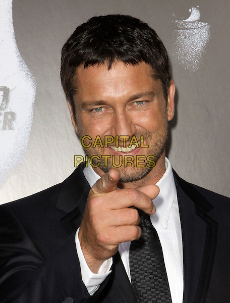 GERARD BUTLER.The Overature Film L.A. Premiere of Law Abiding Citizen held at The Grauman's Chinese Theater in Hollywood, California, USA. .October 6th, 2009 .headshot portrait grey gray black stubble facial hair hand finger pointing .CAP/ADM/KB.©Kevan Brooks/AdMedia/Capital Pictures.