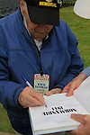 Normandy, WWII veteran Henry Hirschmann signs his autograph at the 70th Anniversary of D-DAY celebrations