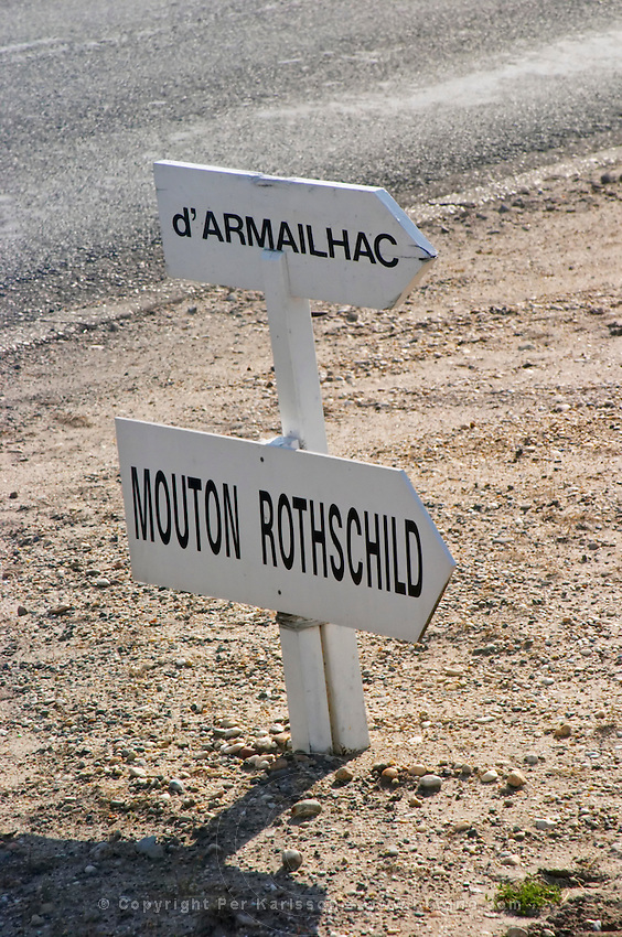 Unassuming Road sign indicating the top quality famous chateaux Mouton Rothschild and d'Armailhac Pauillac Medoc Bordeaux Gironde Aquitaine France