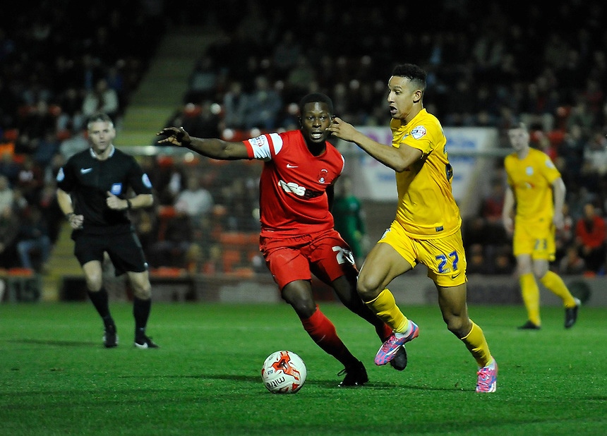 Preston North End's Callum Robinson holds off the challenge from Leyton Orient's Marvin Bartley<br /> <br /> Photographer Ashley Western/CameraSport<br /> <br /> Football - The Football League Sky Bet League One - Leyton Orient v Preston North End - Tuesday 28th October 2014 - Matchroom Stadium - London<br /> <br /> &copy; CameraSport - 43 Linden Ave. Countesthorpe. Leicester. England. LE8 5PG - Tel: +44 (0) 116 277 4147 - admin@camerasport.com - www.camerasport.com