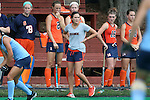 12 September 2014: Syracuse assistant coach Tara Zollinger paces in front of the bench. The University of North Carolina Tar Heels hosted the Syracuse University Orange at Francis E. Henry Stadium in Chapel Hill, North Carolina in a 2014 NCAA Division I Field Hockey match. UNC won the game 3-0.