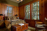 150 year old pine walls create a vintage quality along with the antique brass bed