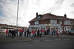 Fleetwood Town 1 Wrexham 1, 10/04/2012. Highbury Stadium, Football Conference Premier. Rival fans queueing outside a traditional fish and chip shop near the ground before Fleetwood Town hosted Wrexham in a Blue Square Conference Premier match at Highbury Stadium. The match, between the top two teams in the division ended in a 1-1 draw watched by a near-capacity crowd of 4996. A victory for the hosts would have seen the club promoted to the Football League for the first time. Photo by Colin McPherson.