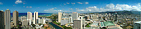 A sweeping panorama of Honolulu, from downtown to Ala Moana Center with Waikiki in the distance.