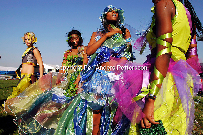 DURBAN, SOUTH AFRICA - July 3: Models dressed up for a fashion competition during the yearly Durban July horse race on July 3, 2004 in Durban in Natal Province, South Africa. Durban July is the biggest horse race in Africa and an important social event, where South Africa's celebrities dress up and watch the races. Durban is a popular tourist destination situated on Indian Ocean.  .(Photo: Per-Anders Pettersson/Getty Images).....
