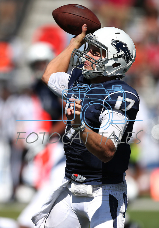 Nevada's quarterback Cody Fajardo (17) passes against Southern Utah in the second half of an NCAA college football game on Saturday, Aug. 30, 2014 in Reno, Nev. (AP Photo/Cathleen Allison)