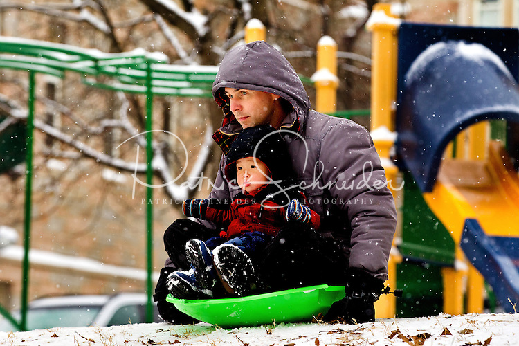 Kids of all ages take advantage of the snow and hills during a January snowstorm in Charlotte, North Carolina.