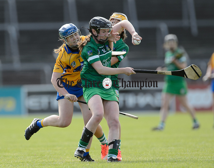 Caoimhe Costello and Karen O Leary of Limerick in action against Maire Mc Grath of Clare during their game in Cusack park. Photograph by John Kelly.