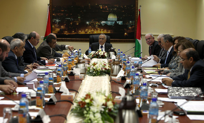 Palestinian Prime Minister, Salam Fayyad heads the Palestinian Cabinet meeting in the West Bank city of Ramallah on April 25, 2011. Photo by Mustafa Abu Dayeh