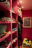 A vibrant pink family boot room provides plenty of storage for shoes, coats and bags.