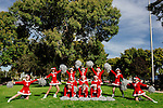 The Sun City Poms gather for a group portrait following a rehearsal for an upcoming performance. The cheerleading squad members range from 57 to 81 years old.