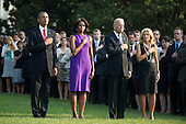 United States President Barack Obama (L), First Lady Michelle Obama, Vice President Joe Biden, Dr. Jill Biden and White House staff observe a moment of silence for the 12 anniversary of the 9/11 terrorist attacks, at the White House on September 11, 2013 in Washington, D.C. <br /> Credit: Kevin Dietsch / Pool via CNP