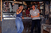 Sao Paulo, Brazil. Favela Vila Prudente shanty town; men drinking at a bar in a shack