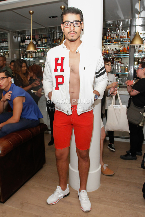 "Model poses in an outfit from the Christopher Lowman Spring Summer 2018 ""Harvard Punk'd"" collection at HGU New York, on July 10, 2017; during New York Fashion Week: Men's Spring Summer 2018."