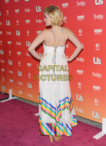 """SHANNA MOAKLER .at The 2009 US Weekly Annual """"Hot Hollywood"""" Party held at My House in Hollywood, California, USA,.April 22nd 2009.                                                                     .full length white dress hands on hips multi-coloured trim striped cleavage halterneck back rear behind .CAP/DVS.©Debbie VanStory/RockinExposures/Capital Pictures"""