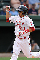 Third baseman Carlos Asuaje (20) of the Greenville Drive is congratulated after scoring a run in a game against the Charleston RiverDogs on Wednesday, June 11, 2014, at Fluor Field at the West End in Greenville, South Carolina. Greenville won, 6-3. (Tom Priddy/Four Seam Images)