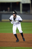UCF Knights pinch runner Maximillian Wood (17) leads off first base during a game against the Siena Saints on February 17, 2017 at UCF Baseball Complex in Orlando, Florida.  UCF defeated Siena 17-6.  (Mike Janes/Four Seam Images)