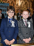 Billy Mac Gheimhridh and Cillian McQuillan from Scoil Aonghuasa who recieved First Holy Communion at St. Peter's church. Photo:Colin Bell/pressphotos.ie