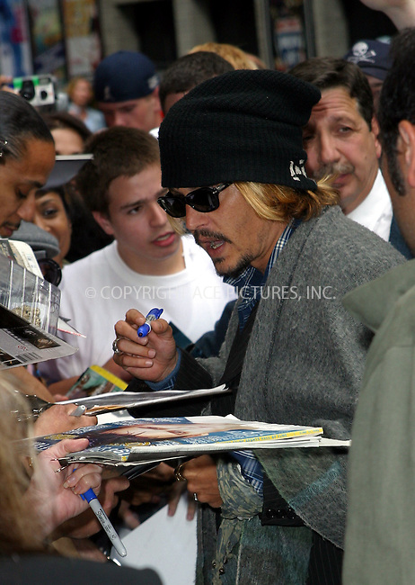 "Actor Johnny Depp looks like a pirate as he signs autographs outside Ed Sullivan Theater in New York. Johnny is to make an appearance on ""The Late Show With David Letterman"" to promote his latest movie, ""Pirates of the Caribbean."" June 18, 2003. Please byline: NY Photo Press.   ..*PAY-PER-USE*      ....NY Photo Press:  ..phone (646) 267-6913;   ..e-mail: info@nyphotopress.com"