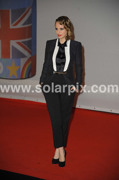 **ALL ROUND PICTURES FROM SOLARPIX.COM**                                             **WORLDWIDE SYNDICATION RIGHTS**                                                                                  Stars arrive at London's O2 Arena for the 2012 Brit Awards..This pic:   Anna Calvi                                      .JOB REF:    14495   MSR     DATE:   22.02.12                                                         **MUST CREDIT SOLARPIX.COM OR DOUBLE FEE WILL BE CHARGED**                                                                      **MUST AGREE FEE BEFORE ONLINE USAGE**                               **CALL US ON: +34 952 811 768 or LOW RATE FROM UK 0844 617 7637**