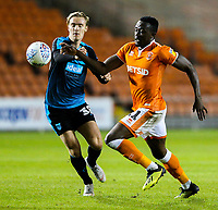 Blackpool's Joe Dodoo vies for possession with West Bromwich Albion U21&rsquo;s Alex Bradley<br /> <br /> Photographer Alex Dodd/CameraSport<br /> <br /> The EFL Checkatrade Trophy Northern Group C - Blackpool v West Bromwich Albion U21 - Tuesday 9th October 2018 - Bloomfield Road - Blackpool<br />  <br /> World Copyright &copy; 2018 CameraSport. All rights reserved. 43 Linden Ave. Countesthorpe. Leicester. England. LE8 5PG - Tel: +44 (0) 116 277 4147 - admin@camerasport.com - www.camerasport.com