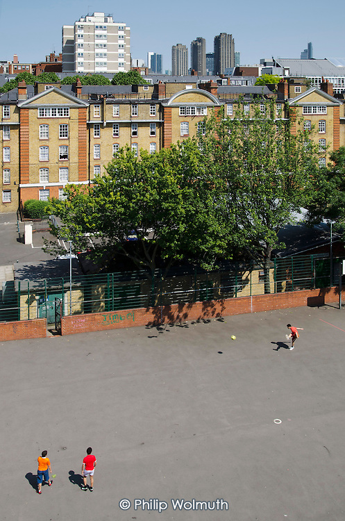 Camden Council housing: boys playing football on Bourne Estate, Holborn