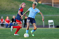 Piscataway, NJ, April 24, 2016.  Sky Blue's Tasha Kai  (32) eludes Megan Oyster (4) of the Washington Spirit. The Washington Spirit defeated Sky Blue FC 2-1 during a National Women's Soccer League (NWSL) match at Yurcak Field.
