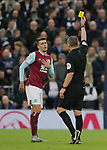 Burnley's Matthew Lowton is shown a yellow card during the Premier League match at the Tottenham Hotspur Stadium, London. Picture date: 7th December 2019. Picture credit should read: Paul Terry/Sportimage