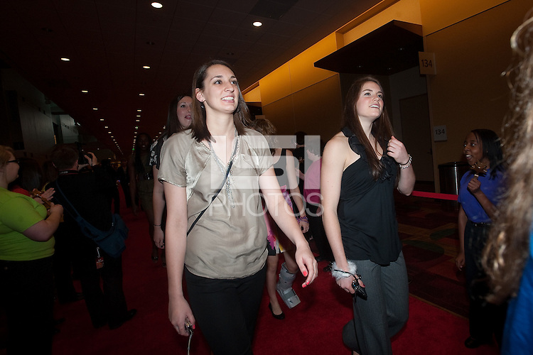 INDIANAPOLIS, IN - APRIL 1, 2011: Ashley Cimino and Sara James walk the red carpet at the Indianapolis Convention Center at Tourney Town during the NCAA Final Four in Indianapolis, IN on April 1, 2011.