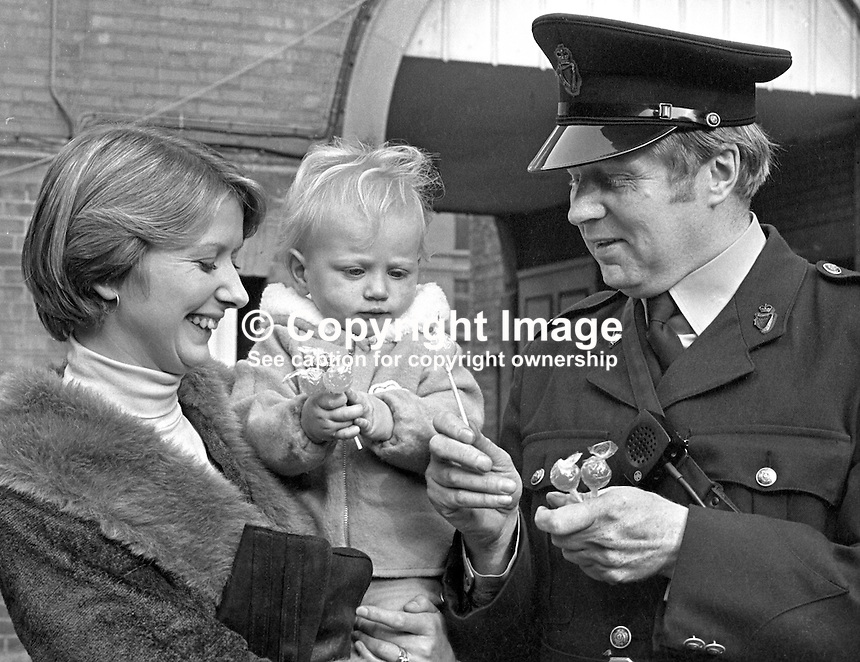 Two year old Stephen Harrison with RUC Constable Tom Coulter who saved his life several months earlier after a Provisional IRA bombing in Rosemary Street, Belfast, N Ireland. The reason for the reunion was Constable Coulter being awarded the Queen's Award for Bravery. In the incident he entered the bombed premises despite the ever-present possibility of a second explosive device. As the baby's face had turned blue he gave it vital heart massage. Constable Coulter then rescued another young boy from the rubble. 197710180191b.  For an injury picture of Stephen search using the following keyword: 19770406wireprint.<br /> <br /> Copyright Image from Victor Patterson, 54 Dorchester Park, Belfast, UK, BT9 6RJ<br /> <br /> t: +44 28 90661296<br /> m: +44 7802 353836<br /> vm: +44 20 88167153<br /> e1: victorpatterson@me.com<br /> e2: victorpatterson@gmail.com<br /> <br /> For my Terms and Conditions of Use go to www.victorpatterson.com