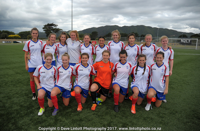 The Auckland team poses for a group photo after the New Zealand Age Group Championships Under-16 Girls match between Auckland (white tops) and Southern at Memorial Park in Petone, Wellington, New Zealand on Wednesday, 13 December 2017. Photo: Dave Lintott / lintottphoto.co.nz