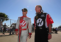 Feb 10, 2008; Daytona Beach, FL, USA; Nascar Sprint Cup Series driver Jeremy Mayfield (left) with a crew member during qualifying for the Daytona 500 at Daytona International Speedway. Mandatory Credit: Mark J. Rebilas-US PRESSWIRE