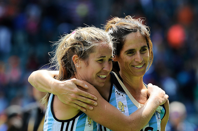 The Hague, Netherlands, June 14: Mariana Rossi #2 of Argentina (R) and Daniela Sruoga #18 of Argentina (L) celebrate after winning the field hockey bronze medal match (Women) between USA and Argentina on June 14, 2014 during the World Cup 2014 at Kyocera Stadium in The Hague, Netherlands. Final score 2-1 (2-1)  (Photo by Dirk Markgraf / www.265-images.com) *** Local caption ***