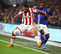 26th November 2019; Cardiff City Stadium, Cardiff, Glamorgan, Wales; English Championship Football, Cardiff City versus Stoke City; Cameron Carter-Vickers of Stoke City holds off the challenge from Junior Hoilett of Cardiff City - Editorial Use - Strictly Editorial Use Only. No use with unauthorized audio, video, data, fixture lists, club/league logos or 'live' services. Online in-match use limited to 120 images, no video emulation. No use in betting, games or single club/league/player publications