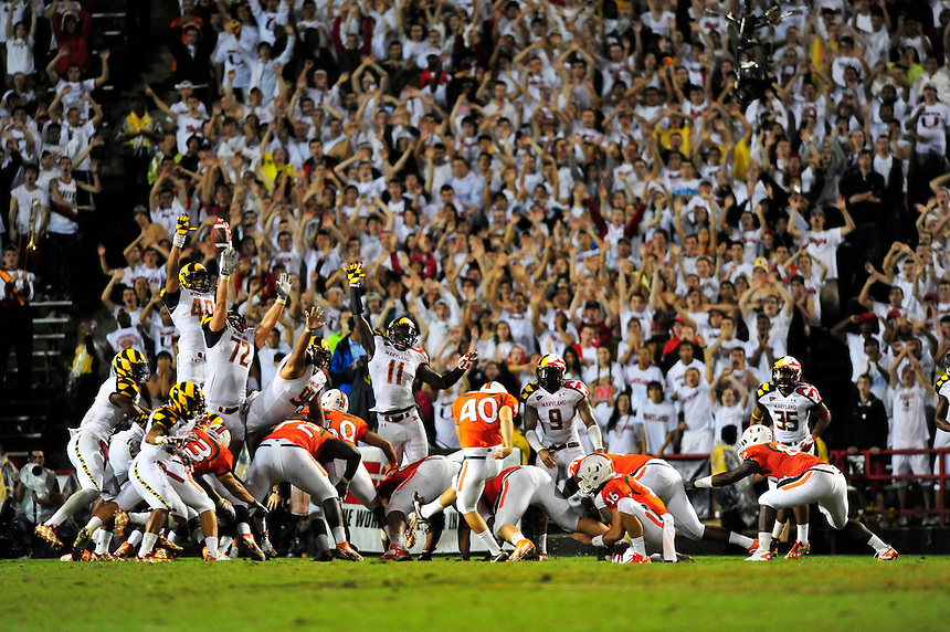 Kicker Jake Wieclaw of the Hurricanes boots a field goal to give his team the lead. Maryland defeated Miami 32-24 during a game at the Byrd Stadium in College Park, MD on Monday, September 5, 2011. Alan P. Santos/DC Sports Box
