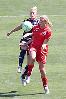 Allie Long #9 of the Washington Freedom battles Keri Sanchez #2 of the Los Angeles Sol for a loose ball during their WPS game at The Home Depot Center on June 7,2009 in Carson, California.  The Sol defeated the Freedom 3-1.