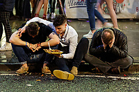 Pictured: Three men share a takeaway meal on the kerb. Sunday 31 December 2017 and 01 January 2018<br /> Re: New Year revellers in Wind Street, Swansea, Wales, UK