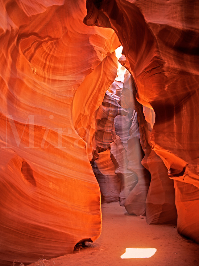 A beam of light from the mid-day sun illuminates the interior of UpperAntelope Canyon near Page Arizona