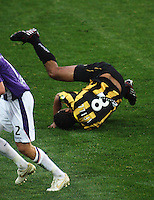 Phoenix striker Paul Ifill takes a tumble during the A-League football match between Wellington Phoenix and Perth Glory at Westpac Stadium, Wellington, New Zealand on Sunday, 16 August 2009. Photo: Dave Lintott / lintottphoto.co.nz