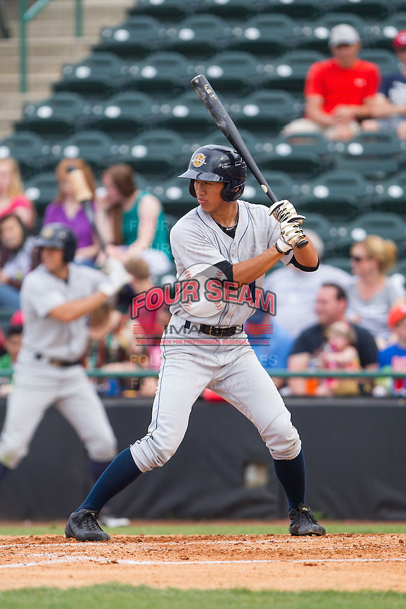 Gosuke Katoh (4) of the Charleston RiverDogs at bat against the Hickory Crawdads at L.P. Frans Stadium on May 25, 2014 in Hickory, North Carolina.  The RiverDogs defeated the Crawdads 17-10.  (Brian Westerholt/Four Seam Images)