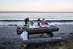 A family having a party on the shore of Lake Baikal on Saturday, October 19, 2013 in Baikalsk, Russia.