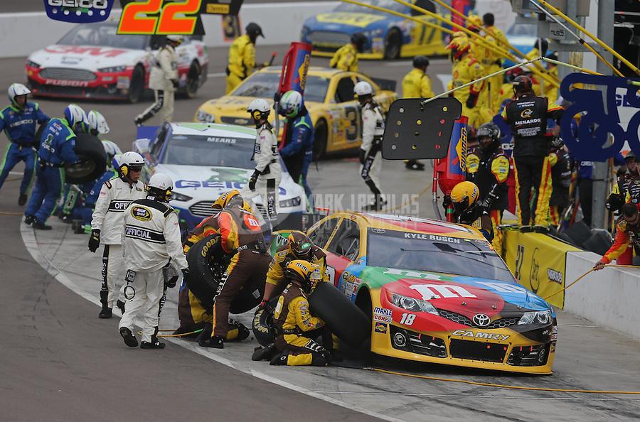 Mar. 3, 2013; Avondale, AZ, USA; NASCAR Sprint Cup Series driver Kyle Busch pits during the Subway Fresh Fit 500 at Phoenix International Raceway. Mandatory Credit: Mark J. Rebilas-