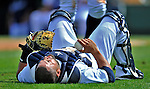 9 March 2012: Detroit Tigers catcher Omir Santos lies on his back after a collision during a Spring Training game against the Philadelphia Phillies at Joker Marchant Stadium in Lakeland, Florida. The Phillies defeated the Tigers 7-5 in Grapefruit League action. Mandatory Credit: Ed Wolfstein Photo
