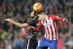 Atletico de Madrid's Jose Maria Gimenez (r) and Athletic de Bilbao's Raul Garcia during La Liga match. December 13,2015. (ALTERPHOTOS/Acero)