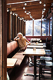 USA, California, Big Sur, Esalen, a woman sits inside the Solarium in the Lodge, the Esalen Institute