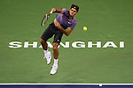 SHANGHAI, CHINA - OCTOBER 13:  Roger Federer of Switzerland serves to John Isner of USA during day three of the 2010 Shanghai Rolex Masters at the Shanghai Qi Zhong Tennis Center on October 13, 2010 in Shanghai, China.  (Photo by Victor Fraile/The Power of Sport Images) *** Local Caption *** Roger Federer