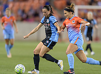 Houston Texas - Amber Brooks (12) of the Houston Dash battles Chicago Red Stars midfielder Vanessa DiBernardo (10) for the ball in the second half on Saturday, April 16, 2016 at BBVA Compass Stadium in Houston Texas.  The Houston Dash defeated the Chicago Red Stars 3-1.