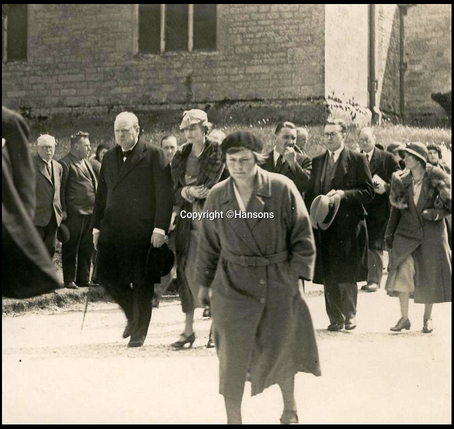 BNPS.co.uk (01202 558833)Pic: Hansons/BNPS<br /> <br /> Winston Churchill attended Lawrence's Dorset funeral in 1935.<br /> <br /> An extraordinary archive of items relating to legendary soldier Lawrence of Arabia has emerged...Including the desert hero's arabian sandals!<br /> <br /> The collection has come from Rodney Havelock Walker whose parents were friends of the enigmatic T E Lawrence and lived near his Clouds Hill home in Dorset.<br /> <br /> As well as the leather sandal's there is a early edition of the Seven Pillers of Wisdom, a school prize book presented to Lawrence in 1903 and a photograph of Cyrene taken by Lawrence before the war.<br /> <br /> Also included is a poignant christening picture of Rodney Havelock Walker on 10th November 1935, its annotated by his parents as being in Lawrence's own christening robes. The war hero had died in suspicious circumstances just 7 months earlier.<br /> <br /> Hansons - December 19th -  Est £3000.