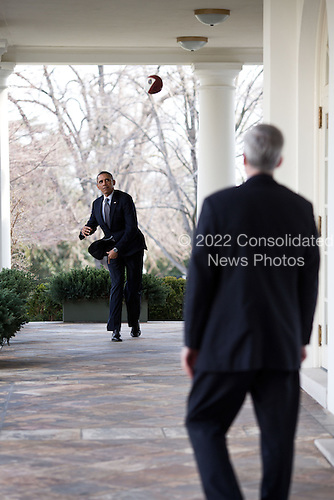 United States President Barack Obama throws a football with Chief of Staff Denis McDonough on the Colonnade of the White House, March 15, 2013. .Mandatory Credit: Pete Souza - White House via CNP